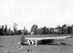 Ford-built CG-4A glider sitting in a pasture, Normandy, France, Jun 1944
