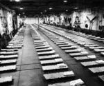 Hangar bay of HMS Colossus while on repatriation duty, Jinsen Prisoner of War Camp, Inchon, Korea, Sep 1945
