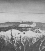 C-46 Commando aircraft flying over the Himalaya Mountains, 1943-1945
