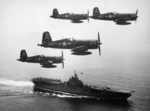 F4U-4 Corsair fighters of US Navy squadron VF-884 flying above USS Boxer, off Korea, 4 Sep 1951