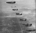 US Navy P4Y1P Liberator, SNB-2P, F4U-5P Corsair, F6F-5P Hellcat, F8F-2P Bearcat, F9F-5P Panther, and F2H-2P Banshee aircraft in flight, circa 1952; seen in Aug 1952 issue of US Navy publication Naval Aviation News