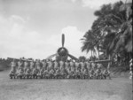 Men of US Marine Corps squadron VMF-214 posing with a F4U Corsair fighter, Turtle Bay fighter strip, Espiritu Santo, New Hebrides, circa Sep 1943