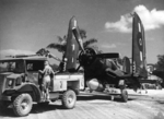 F4U-1 Corsair fighter of No. 16 Squadron Royal New Zealand Air Force being towed at Green Island (now Nissan Island), 21 Dec 1944