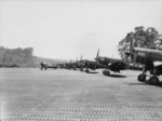 Australian Boomerang fighter of No. 5 Squadron RAAF taxiing past RNZAF F4U-1 Corsair fighters, Cape Torokina, Bouganville, Solomon Islands, 15 Jan 1945