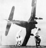 F4U-4 Corsair fighter in the midst of a failed carrier landing attempt on USS Sicily, 1949; seen in Nov 1978 issue of US Navy publication Naval Aviation News