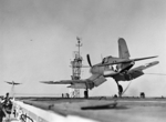 F4U-1 Corsair fighter of US Navy squadron VF-17 landing on USS Charger, Feb 1943
