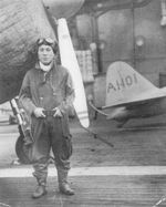 Japanese Navy pilot Lieutenant Zenji Abe posing in front of a A6M2 Zero fighter aboard Akagi, late 1941-early 1942