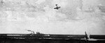 A D3A1 dive bomber about to crash into the sea near USS San Diego, Battle of the Santa Cruz Islands, 26 Oct 1942; seen in 15 Apr 1943 issue of US Navy publication Naval Aviation News
