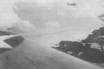 Lieutenant Commander Bill Burch and Ensign Thomas Reeves flying SBD dive bombers over Makin, Gilbert Islands, 1 Feb 1942