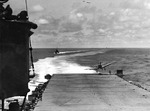 SBD Dauntless aircraft landing aboard USS Hornet during the Battle of Midway, 4 Jun 1942; note Landing Signal Officer undernearth the landing aircraft