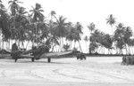 A-24B-5-DT Banshee aircraft (serial number 42-54459) of US 531st Fighter Squadron following a Jeep down the runway on Makin Island, Gilbert Islands, 13 Dec 1943; this was the first A-24B to arrive on Makin