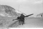 German glider troops operating a radio during Operation Eiche, Gran Sasso, Italy, 12 Sep 1943; note wing of a landed DFS 230 glider in background