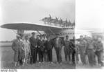 German pilot Christiansen, American pilot Schildhauer, and others posing with a Do X flying boat before making a trans-Atlantic flight from Europe to North America, Nov 1930
