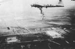 "B-17G Fortress ""Liquid-8-Or"" of 569th Bomb Squadron dropping cases of ""10 in 1"" rations into Holland during Operation Chowhound aimed at breaking the famine in western Holland, May 1 or 3 1945."