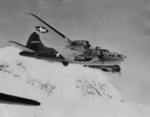 B-17 Flying Fortress bomber in flight over Mount Rainier, Washington, United States, 28 Jul 1943; note the special external hardpoints modification