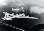 B-17 Flying Fortress bomber and B-29 Superfortress bomber in flight together during a test conducted by Boeing, circa late 1944, photo 2 of 3