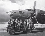 Air crew posing on Jeep in front of B-17F