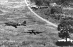 USAAF A-20 Havoc aircraft attacking a Japanese airfield at a low altitude, Lae, New Guinea, circa 1943; note G4M bomber on the ground