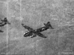 Gun camera still by Flight Sergeant Batchelor No. 457 Squadron RAAF of Japanese G4M1 bombers in flight near Darwin, Australia, 6 Jun 1943