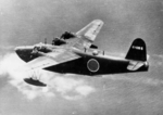 H8K flying boat in the midst of being shot down by the US Navy PB4Y-1 Liberator aircraft of Patrol Squadron VP-115 from which this photograph was taken, 2 Jul 1944. Photo 1 of 2.