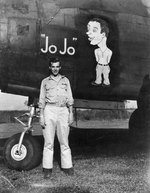 USAAF 3rd Bomb Group airman posing alongside of the nose art of A-20 Havoc aircraft