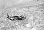 A British DB-7B Boston Mk III bomber of RAF No. 88 Squadron over Dieppe Harbour, France, 19 Aug 1942