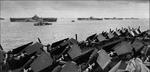 Four Essex-class carriers at anchor at Ulithi, Caroline Islands, about 1600 on 2 Dec 1944; L to R: Wasp, Yorktown, Hornet, Hancock; viewed from Ticonderoga with sight of her F6F-5 Hellcat fighters