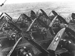 14 Curtiss SB2C Helldiver aircraft on after flight deck of an Essex-class carrier, late 1943 to 1945, location unknown
