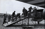 British troops loading 6-pdr anti-tank gun aboard Horsa Mk I glider through side door, England, United Kingdom, Jun 1944; note gun