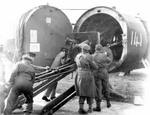 British troops loading field gun aboard Horsa Mk II glider with glider nose section swung away, date unknown
