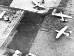 Horsa gliders on the ground near Arnhem, the Netherlands during Operation Market Garden, Sep 1944, photo 2 of 2; note tail sections removed for quick exit of troops and a jeep