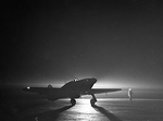 British Hurricane fighter of No. 85 Squadron RAF taxiing at Debden, Essex, England, United Kingdom at night, 14 Mar 1941; note navigation lights on wingtips