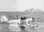 United States Coast Guard J2F-6 Duck aircraft resting in Antarctic waters during Operation Hughjump, 7 Jan 1947; ship in background was either USS Yancey or USS Merrick