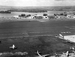 View of Naval Air Station Ford Island, Oahu, US Territory of Hawaii, Jan or Feb 1942; note J2F Duck, JRS, OS2U, and R3D (tail only) aircraft, USS Curtiss, and Northampton-class cruisers