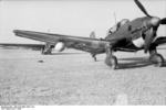 German Ju 87 Stuka dive bomber being prepared to tow a DFS 230 glider, Sicily, Italy, 1943, photo 1 of 2