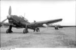 German Ju 87 Stuka dive bomber being prepared to tow a DFS 230 glider, Sicily, Italy, 1943, photo 2 of 2