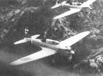 Two Ki-32 aircraft in flight over hilly terrain, date unknown