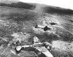 Bomb Damage Assessment photo of destroyed Ki-48 bombers at a Japanese airstrip in northern New Guinea, 1942-1943, photo 1 of 2