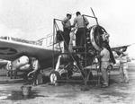 US Navy Scouting Squadron 44 (VS-44) maintenance crew working on a land-variant OS2U Kingfisher aircraft, Hato Field, Curaçao, Dutch West Indies, circa early to mid 1943
