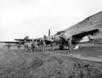 F5 photo reconnaissance aircraft on an airstrip at Amchitka, Aleutian Islands, 7 May 1942; note C-47 transport aircraft in background