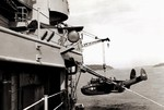 US Navy PBM-5 Mariner aircraft being hoisted onto a seaplane tender, early 1950s