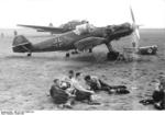 German Luftwaffe crew relaxing on an airfield, 1939-1940; note Bf 109 fighter of JG 53