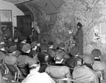 USAAF bomber crews at a briefing in England, United Kingdom, 1944-1945; note drawing of Me 163 Komet jet fighter on the map