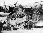 A German armored halftrack vehicle being loaded into the nose doors of a six-engine Luftwaffe Me 323 Gigant transport, date unknown