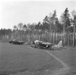 Me 410 aircraft at rest at an airfield, late 1945, photo 2 of 2