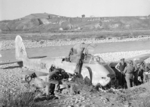 RAF Regiment troops inspecting a downed Me 410A-3 aircraft near the Sangro River, Italy, shortly after it was shot down on 26 Nov 1943