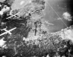 B-25 Mitchell bombers of US Army ComAirSols Bomber Command attacking Rabaul, New Britain, circa late 1943; note Lakunai airfield in top center of photo