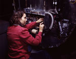 Female employee of North American Aviation working on switch boxes on the firewalls of B-25 Mitchell bombers, Inglewood, California, United States, Oct 1942