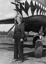Actress Phyllis Brooks with a B-25 bomber, Dobodura Airfield, Australian Papua, mid-1943