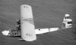 P2Y-1 aircraft of US Navy squadron VP-10F in flight, 1930s; note four-star flag near cockpit indicating an admiral was onboard